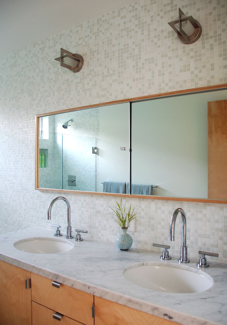 "Oreck used the same ply he used throughout the rest of the house for the master bathroom, which has dual sinks for the couple. The mosaic tile is from Trend; the fixtures are from Newport Brass.  ""This layout is as space efficient as you can get—we had no"