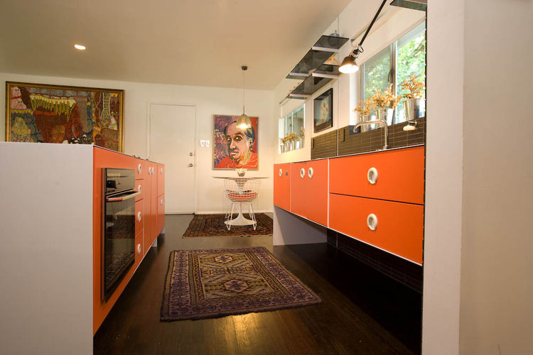 The original white-oak floors were continued into the kitchen and ebonized throughout the apartment.