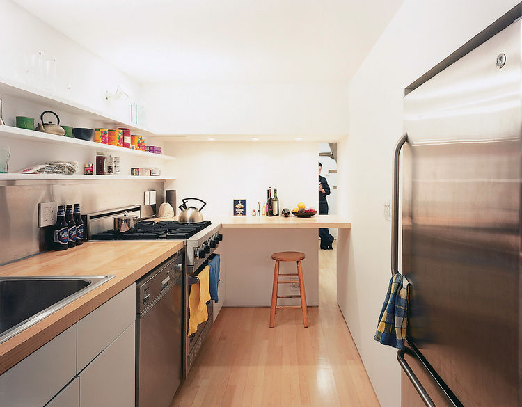 """""""The dimensions are so tight, the height especially,"""" says the architect. """"By densifying the core—the bathroom, kitchen, and bedroom—the rest became much more spacious than it used to be."""""""