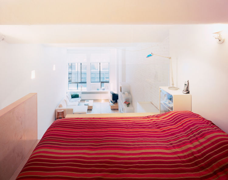 """""""The sense of fragility is kind of nice,"""" says Woo of the glass pane that forms the bedroom wall. """"I was seriously considering translucent glazing. That would still have let the light come through, and might have created a more cozy space and given privac"""