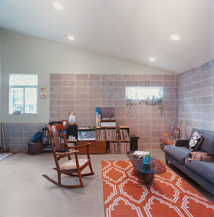 A carefully placed window illuminates the corner of the main living area.