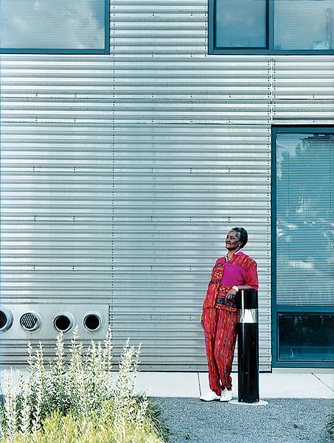 The building's stark but well-windowed exterior is clad with ridged sheets of stainless steel. Dorothy Barry steps outside for a breath of fresh air.