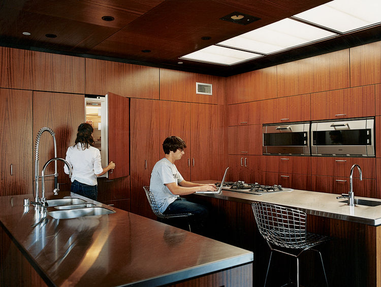 Segal designed the kitchen cabinets. The oven and cooktop are by Gaggenau; the sink is by Franke.