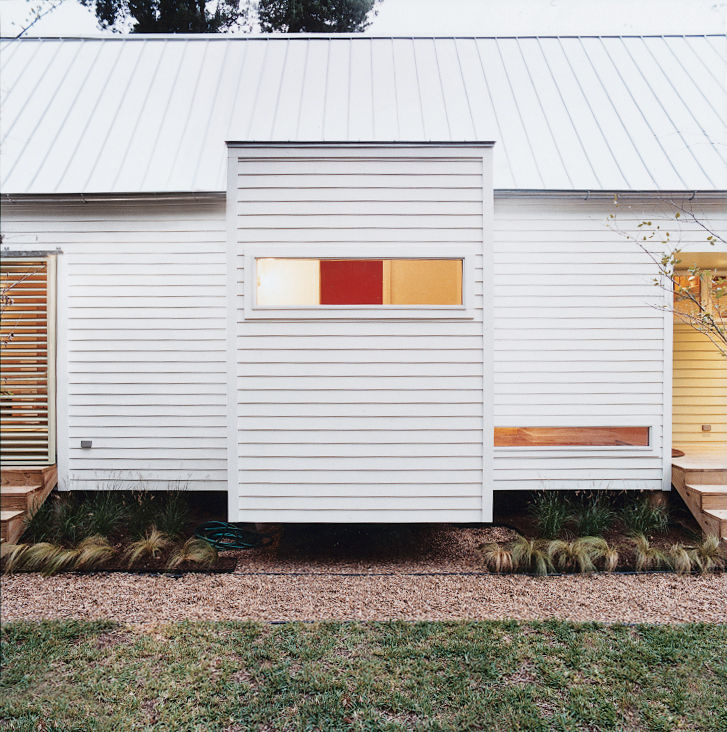 The Shot-Trot's two bathrooms are housed in eight-by-eight cubes that cantilever off the main space while maintaining the preordained grid.