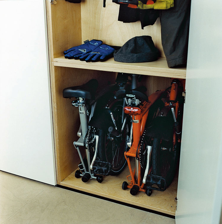 The storage of the bicycles and cycling gear was a major factor in the design of the cupboard space. The floor is plain and simple to clean, which is essential for those wet winter days when they return home from work with muddy wheels and dripping clothi
