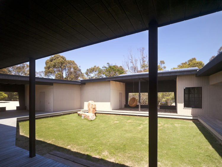 Viewed from the circular drive out front, the courtyard is the house's defining feature. With a shaded walk all the way around it, and a northward siting, the space makes use of passive solar techniques to remain temperate even in hot Victorian summers.