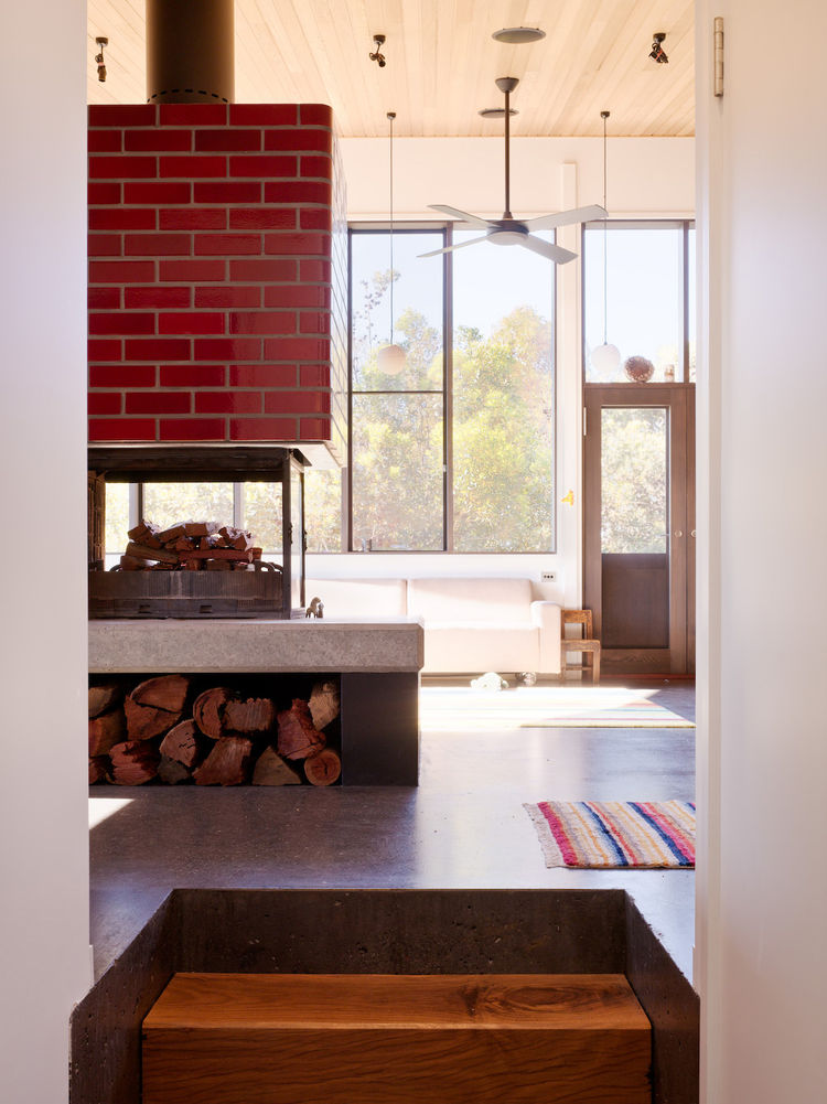 Set up on a concrete plinth and covered in large tiles, the fireplace actually acts as a thermal mass that helps keep things toasty in the cold Victorian winters. Unlike the region around Sydney, the Melbourne area has quite a drastic change in climate th
