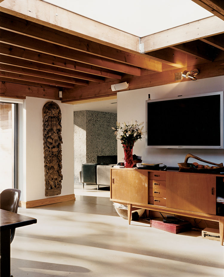 An expansive skylight gives a feeling of spaciousness to the kitchen/dining area.