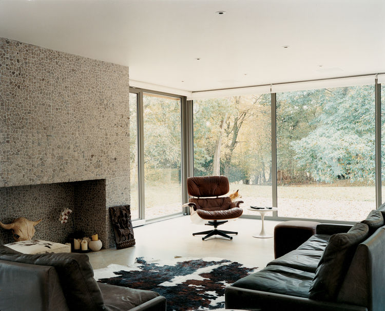The living room's floor-to-ceiling windows allow plenty of natural light in and offer a clear view of the woods to the rear of the property. Carver is a fan of taxidermy and his stuffed vixen has attracted a number of real-life suitors. The fox (behind th