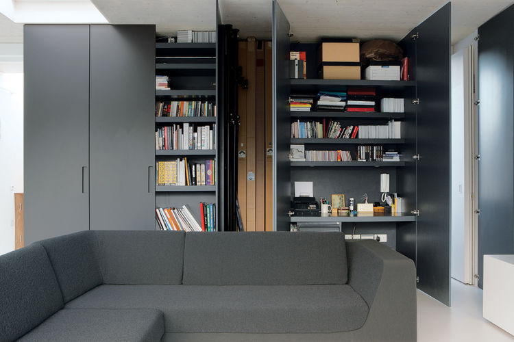 Reeve's partner, Michela Meazza, uses built-in closets for her home office. The imposing gunmetal gray doors can simply be swung shut at the end of a long day's work. The sofa is by Rock Galpin.