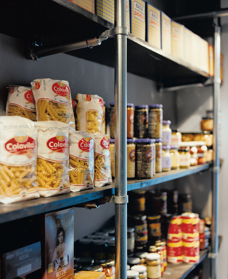 """We said to Grupo 7, 'We need you to use the cheapest materials possible, but in a really cool way,'"" Mazza recounts. Chain-link fence poles hold up the racks of food in the market and support the grid of lights on the ceiling."