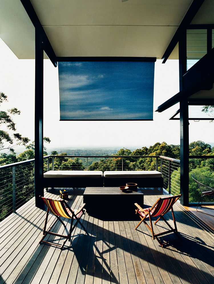 A large deck off the living room overlooks the hills of Noosa and the Pacific Ocean.