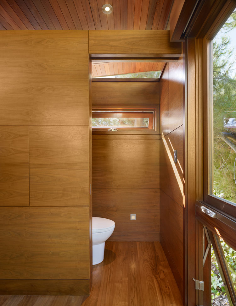 The tree house serves also as temporary guest quarters, with modern-day amenities like a daybed, a sink, a toilet, a small refrigerator, a fireplace and a microwave.