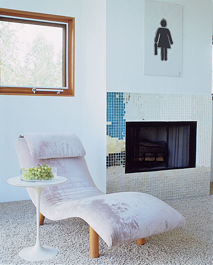 This chaise, found at a flea market and reupholstered in pink velvet adds texture to the decor.