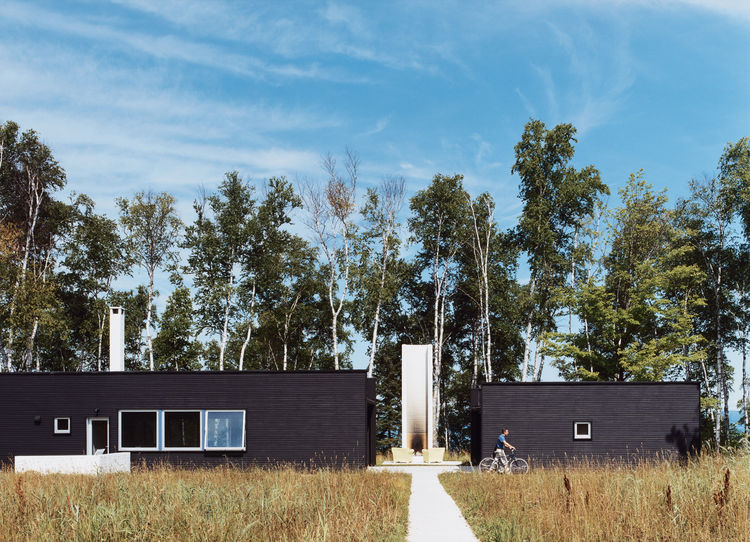 Two Black Sheds incorporates all the conventional aspects of a weekend retreat in a rather unconventional way.