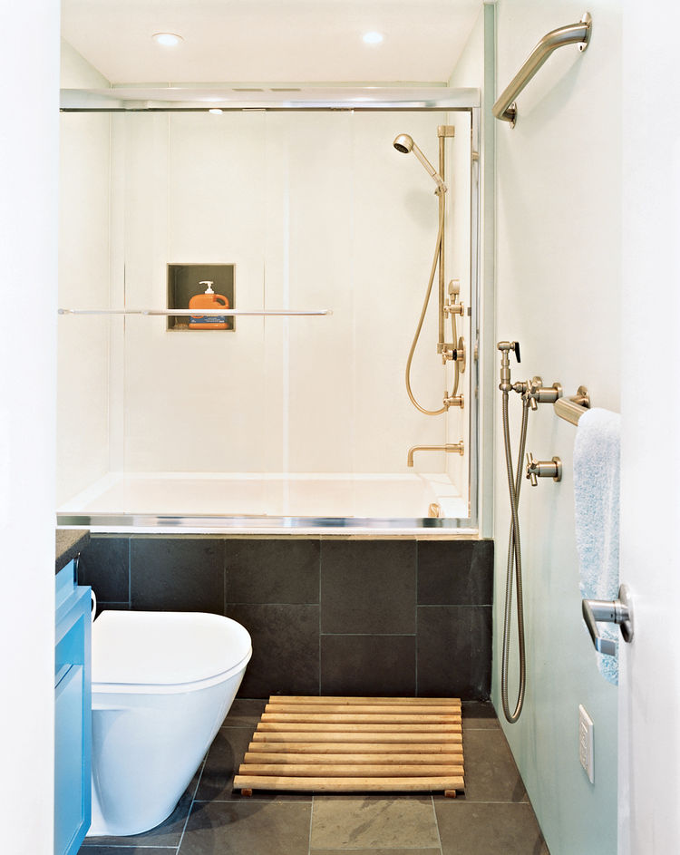 "Their bathroom has walls of watertight Plexiglas. ""They were so easy to set up,"" John says, ""the contractors installed all six bathrooms in one day."""
