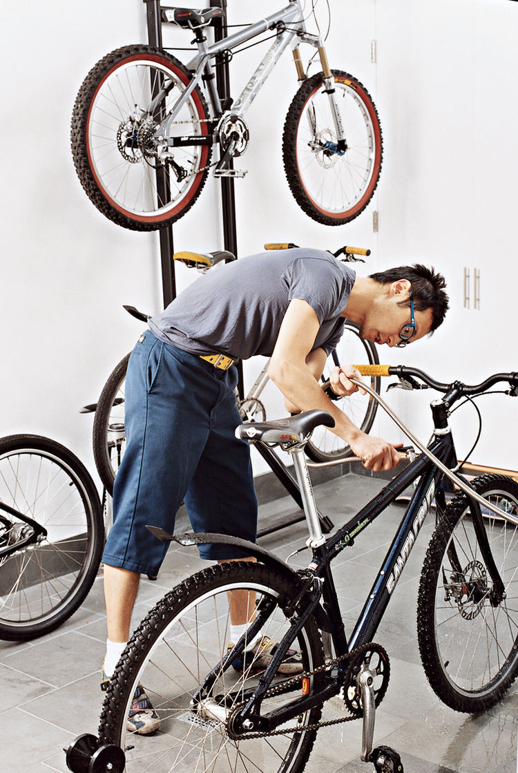 """Between the kitchen and main entrance is a large mudroom where Andy keeps """"a bike for every season, including two one-speeds."""" The slate floor, with a drain and a hose in the wall, facilitates mud removal."""