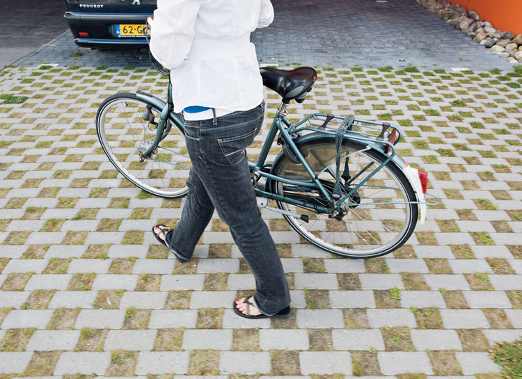 Nineteen-year-old Yvette Sweringa arrives at the villa by bike.