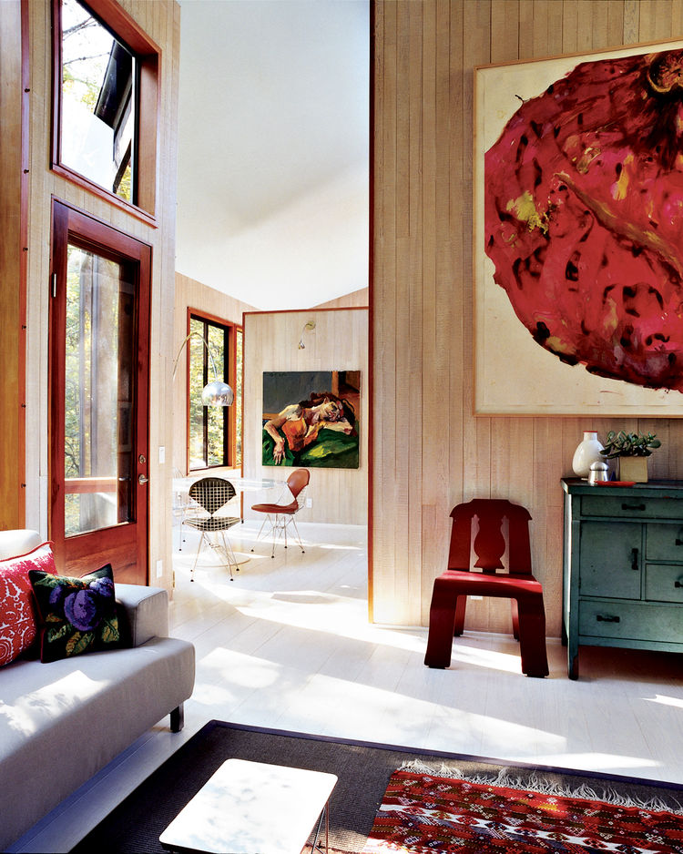 Natural light fills the home, which Watson and Tschopp decorated with a mix of modern classics, thrift-store finds, and more contemporary design pieces like the Cappellini couch.