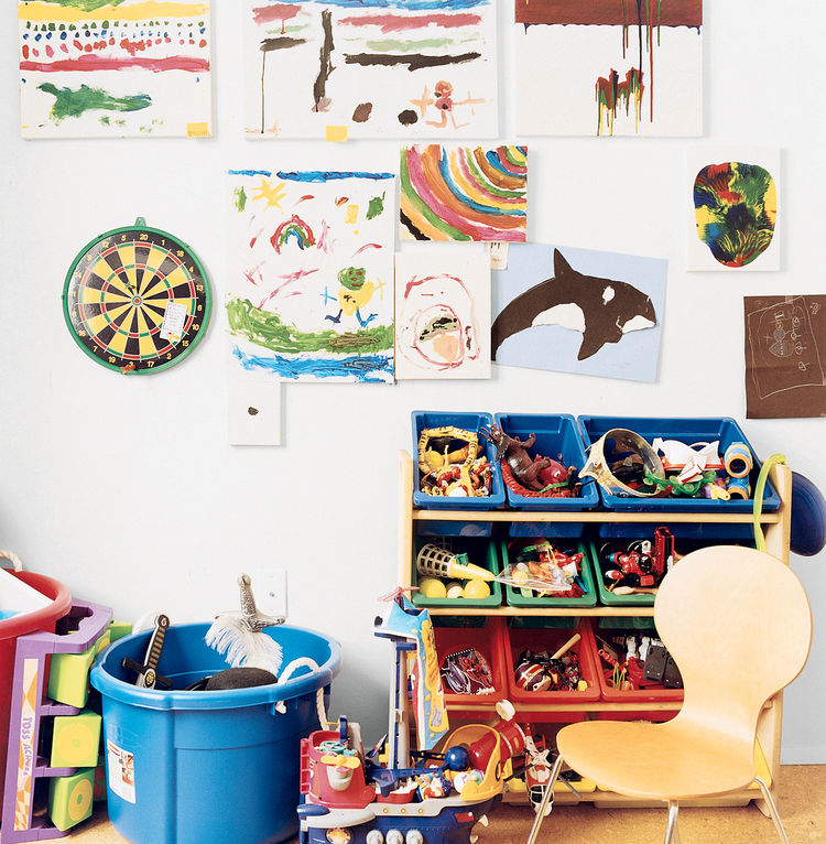 "Six-year-old Mateo's bedroom, which he calls his ""office,"" provides an interesting contrast to his parents' orderly space. His talents are evident in his paintings, including ""Dalmation"" (a white sheet of paper with a single black dot in the center)."