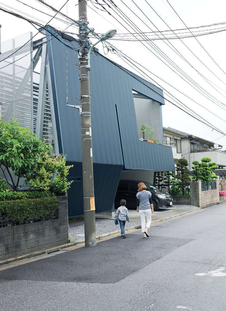 """""""Everyone stops to look at the building,"""" says Motoshi. Neighbors may stare at the severe facade, but once inside they are amazed with the quality and comfort of his home. Its efficient design comes from IDEA Office's clever rethink of local zoning regula"""