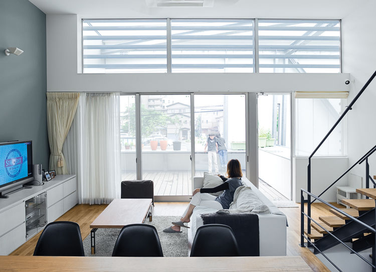 The family's hub is a high-ceilinged main room on the second level. It's open and casual and gets lovely morning light.