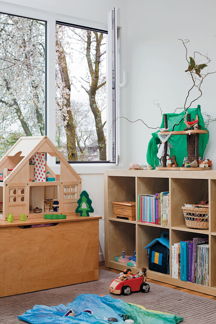 With white walls, rooms take on the characteristics of their inhabitants, such as in Zoë and Ari's bedroom with its Ikea shelves of toys, books, and trinkets.