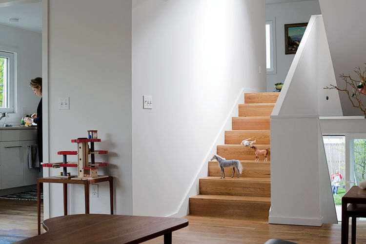 """""""To maintain the seamless connection from room to room, it was important that the flooring material was the same throughout the house,"""" Waechter says. """"We took that continuity down to the smallest detail, eliminating the nosing so the treads look like a f"""