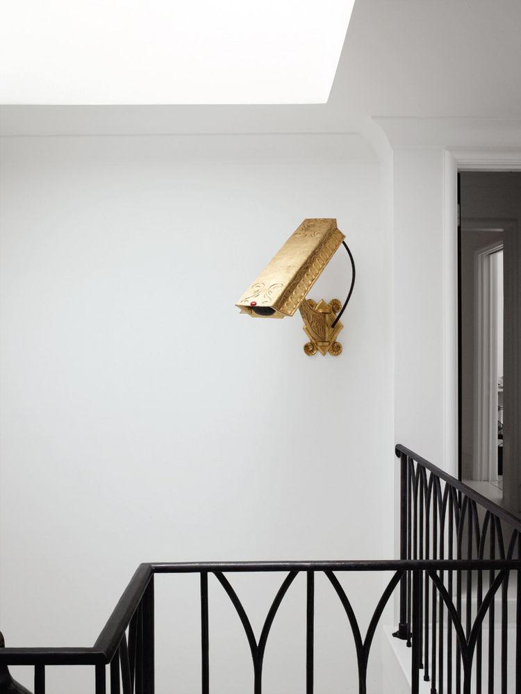 Camp Bosworth gold surveillance camera art