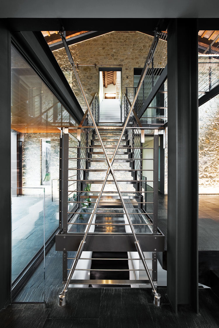 Modern sleek glass and steel stairs