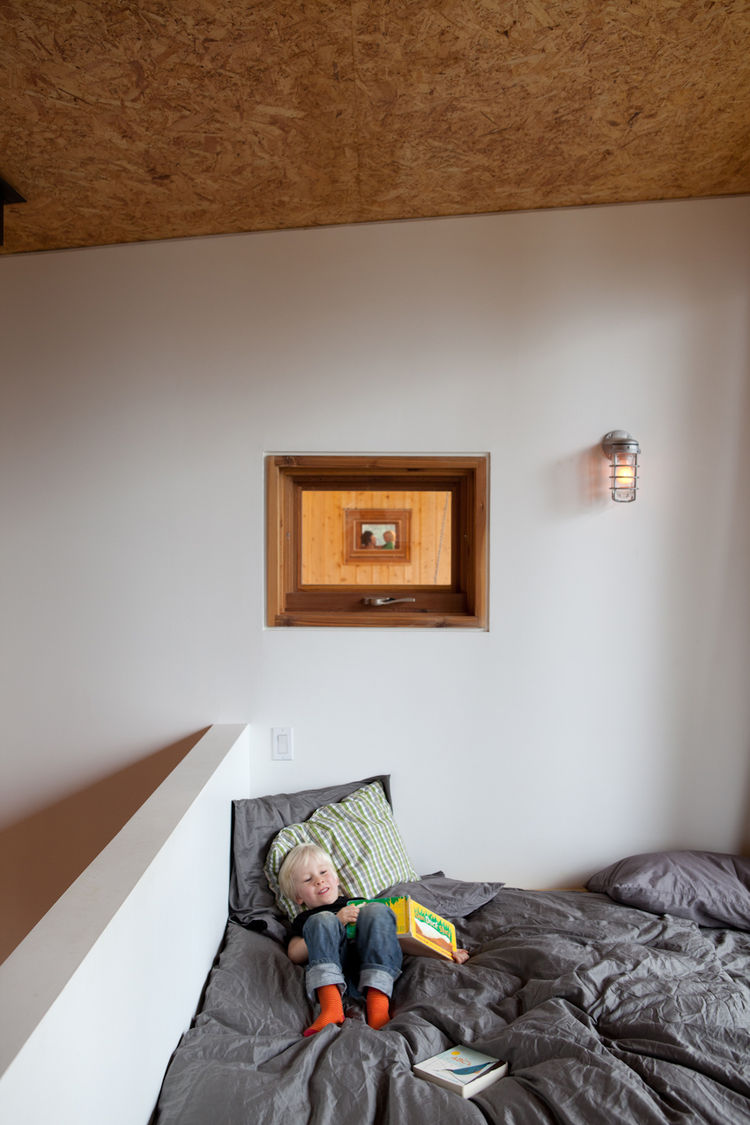 Lofty kids bedroom with wooden ceiling