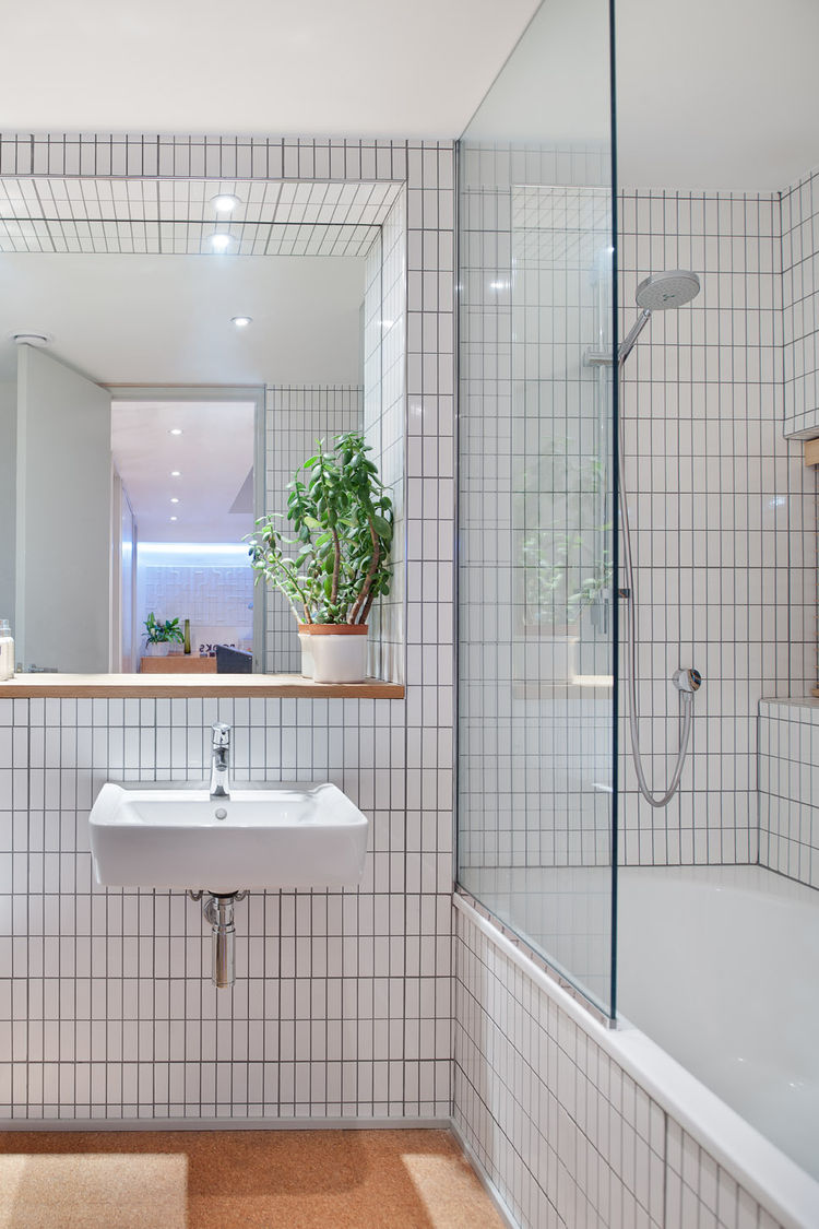Clean design bathroom with glass shower door