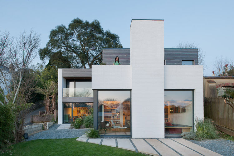 Geometric home facade and upstairs balcony