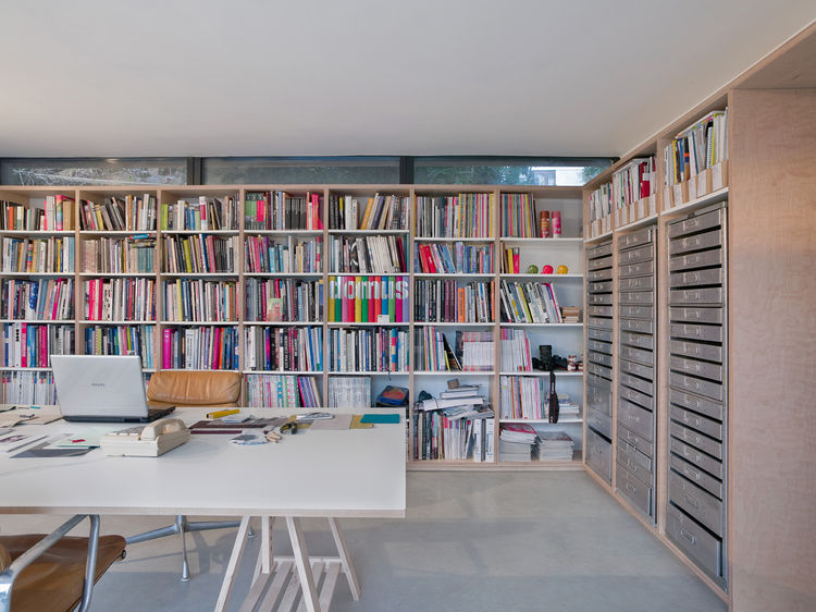 Creatively organized library with multiple bookshelves
