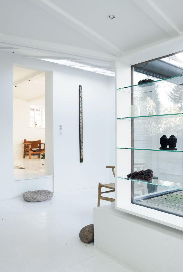 Skylight in entrance minimalist glass shelves