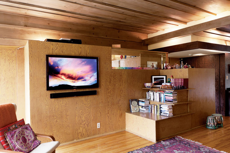 Bubeshko Apartments wooden bookshelves