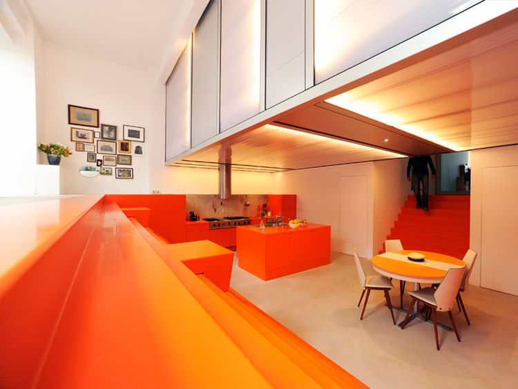 Neon orange dining room with long wooden slats