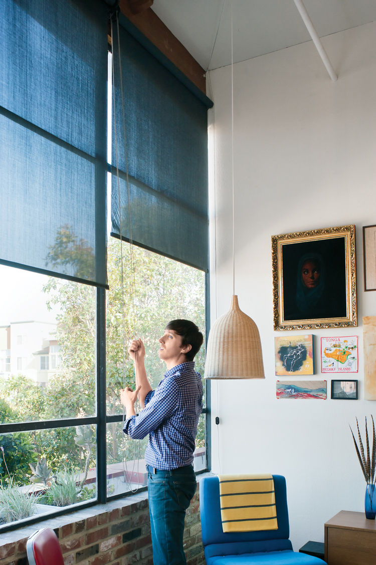 Clutched window roller shades in living room