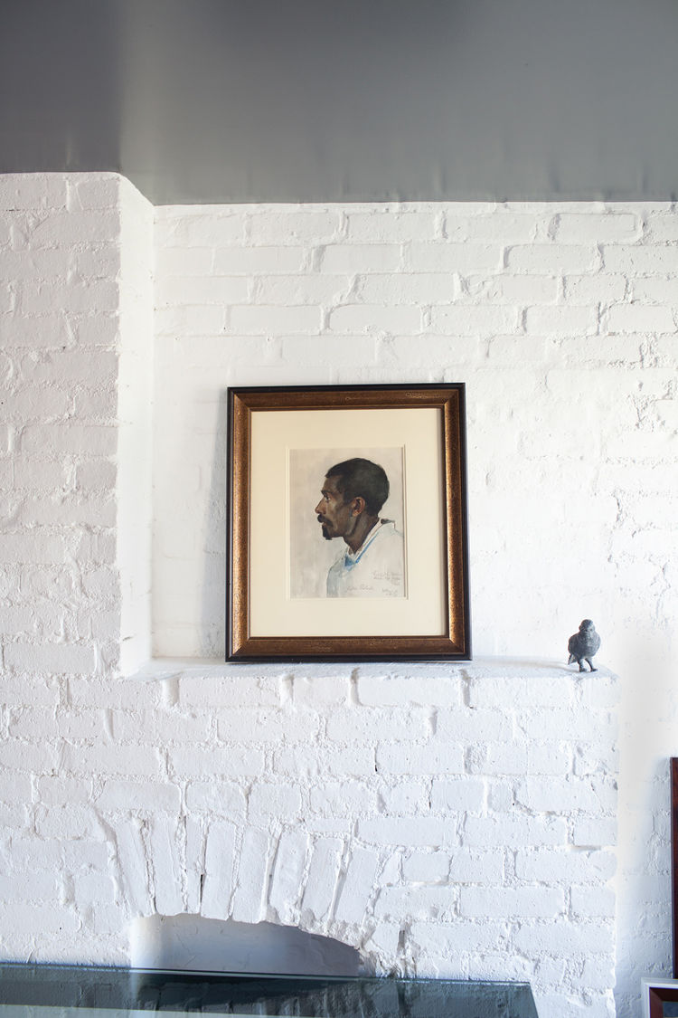Watercolor portrait on painted white brick wall