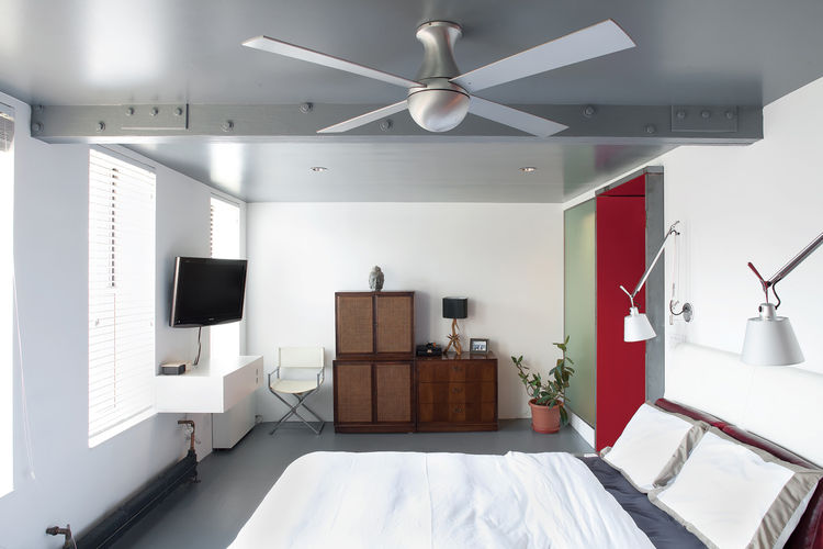 Modern bedroom with ceiling fan
