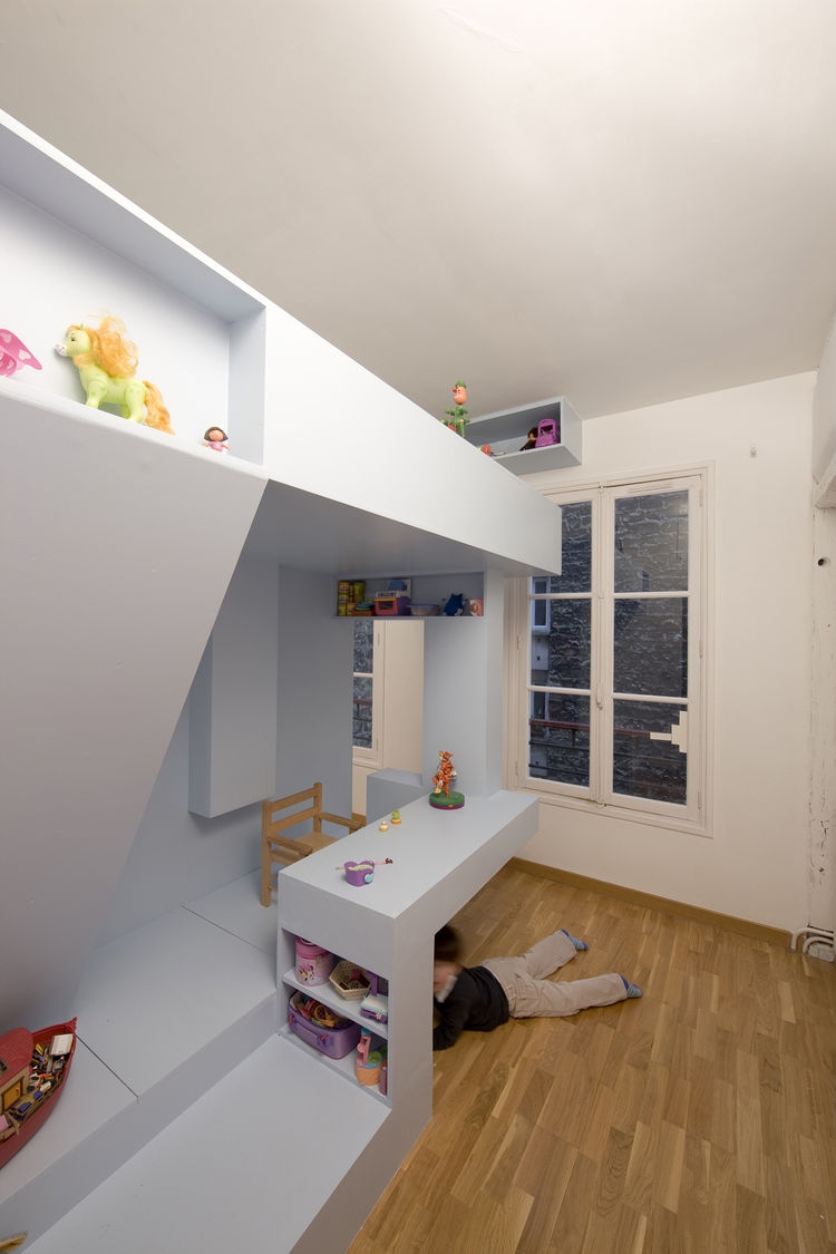 The beauty of the design is that there's no one way to use the space; the architects let the children determine how to use the different elements of the room. Though the desk is often used for tea parties and drawing, it can also become a handy hiding pla