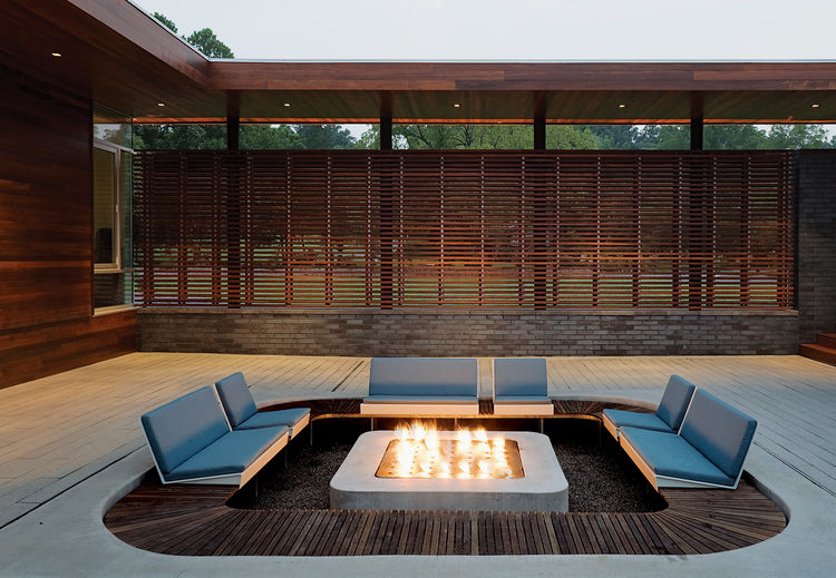 Outdoor sunken seating area with concrete fire pit