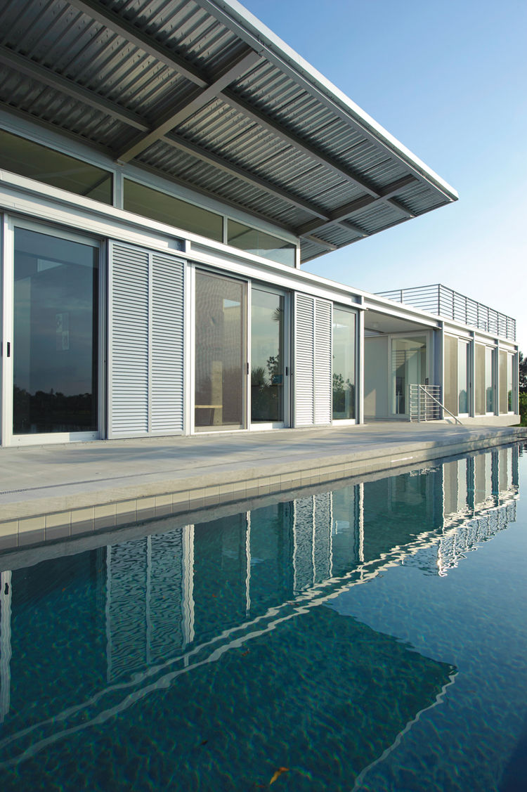 The Ski House H2o, a home in Hobe Sound, Florida overlooking a custom-built water-ski circuit.