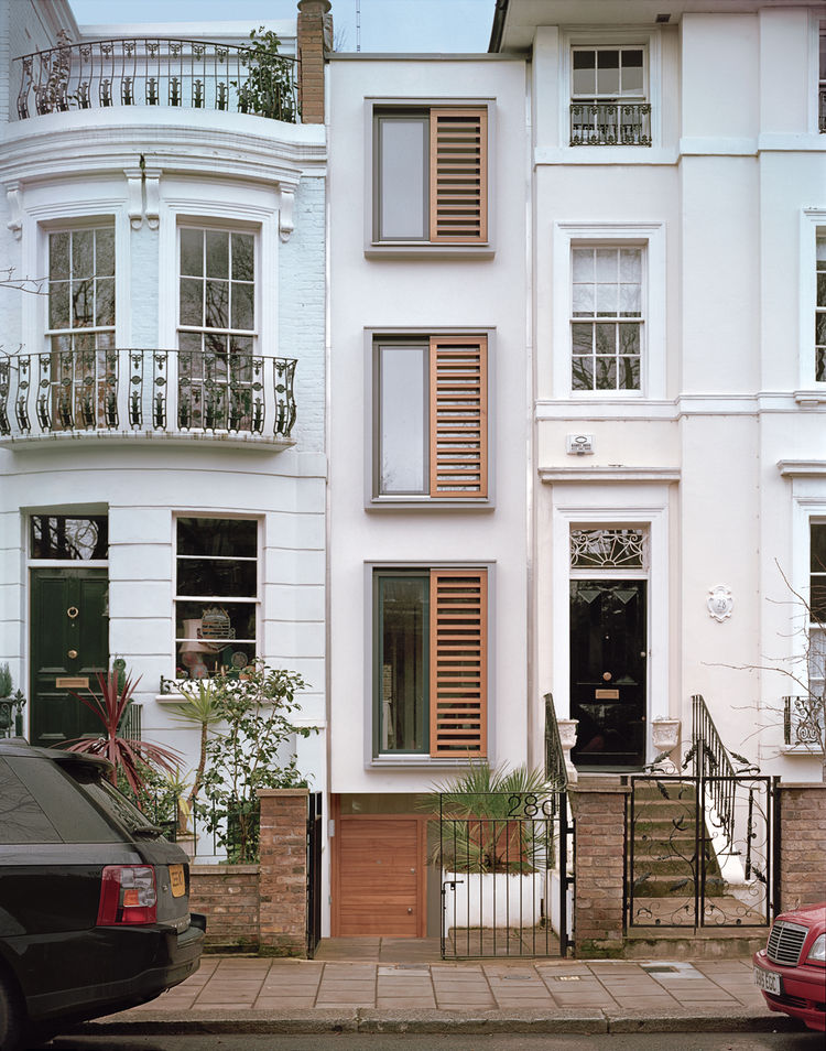 On an eight-foot-wide site in London, architect Luke Tozer cleverly squeezed in  a four-story home equipped with rain-water-harvesting and geothermal systems.