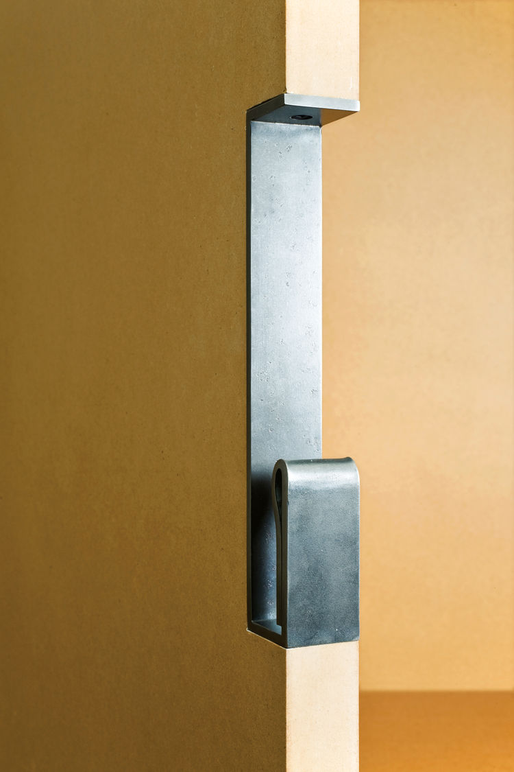 Powder-coated steel door handle by Tom Kundig