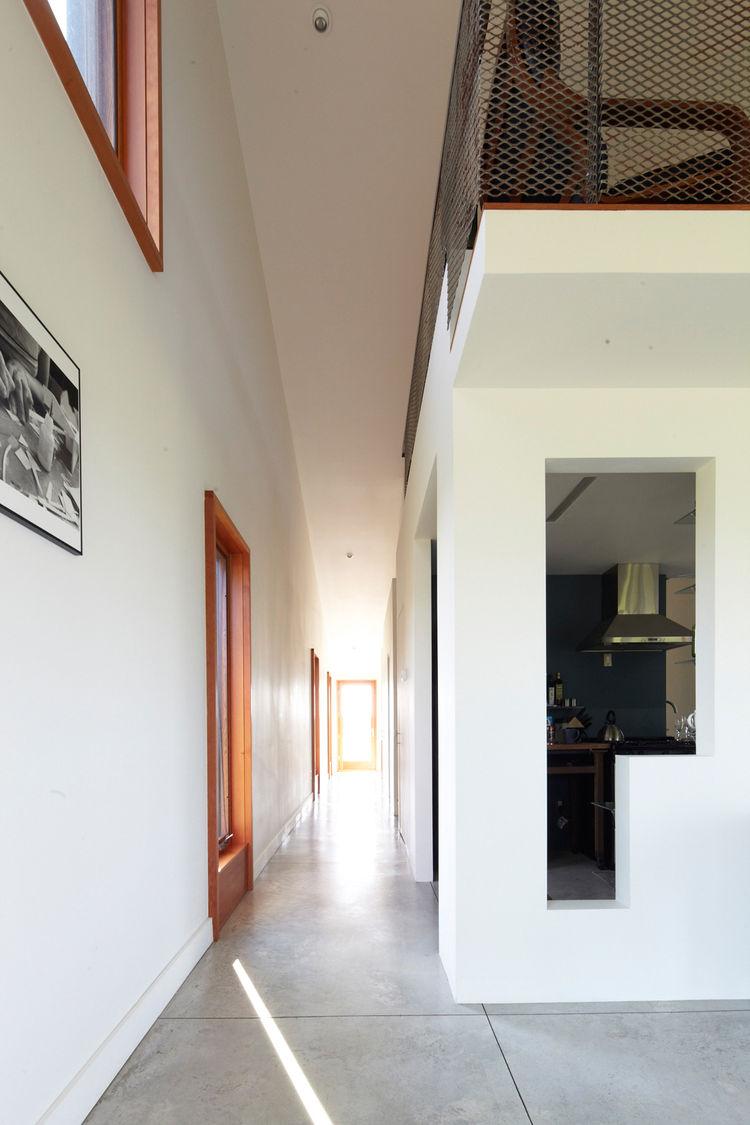 Modern home hallway with stone flooring