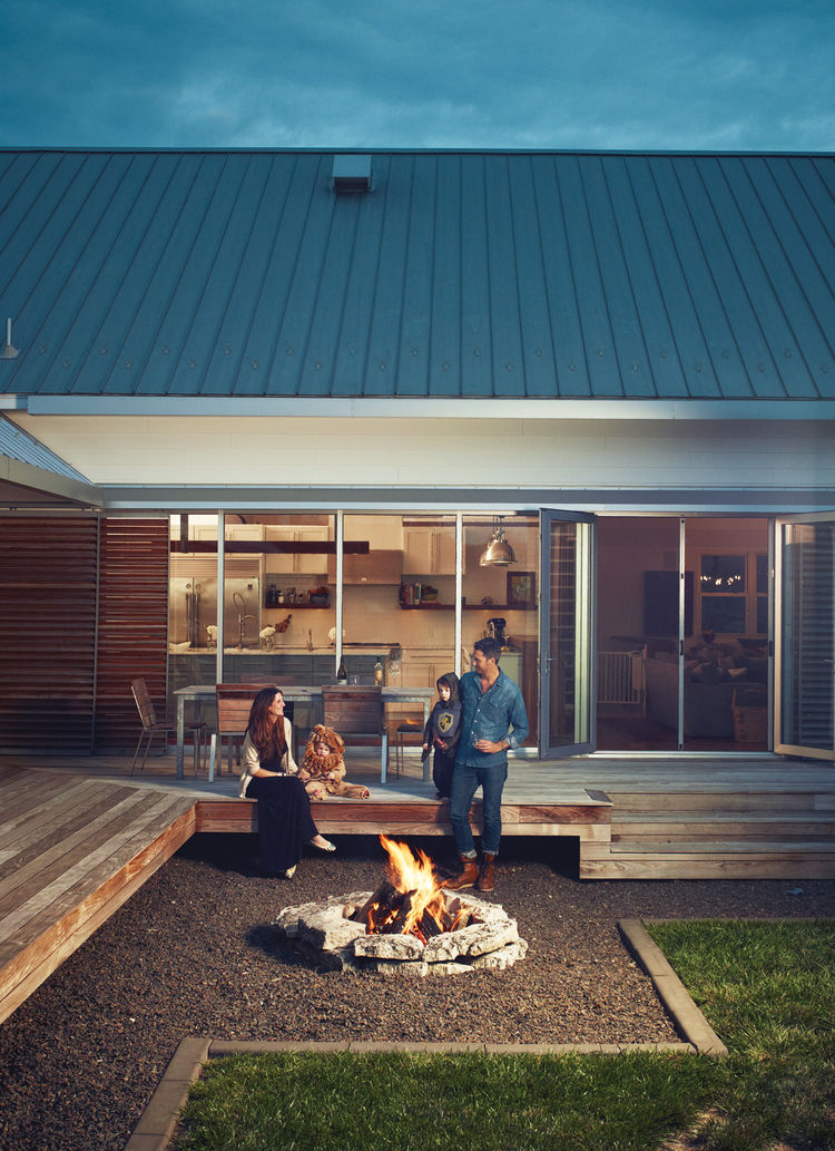 Modern family gathering at the outdoor fire pit