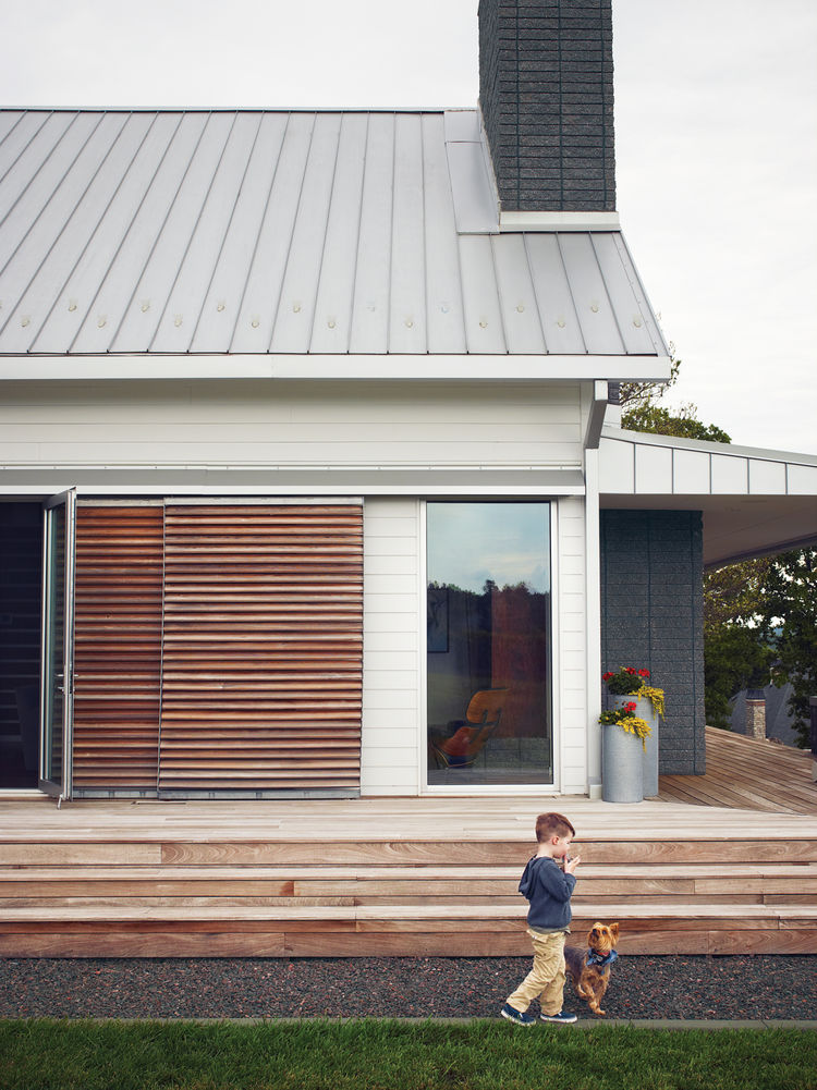 Modern wraparound wooden porch with long steps
