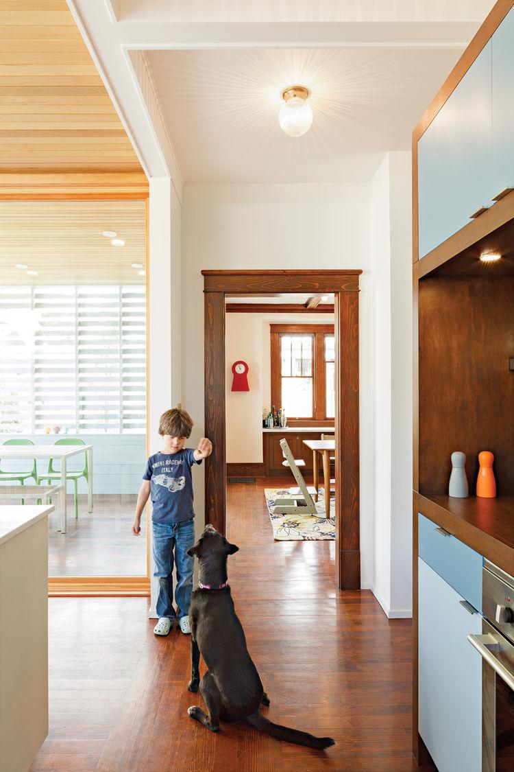 Modern kitchen hallway with fir flooring