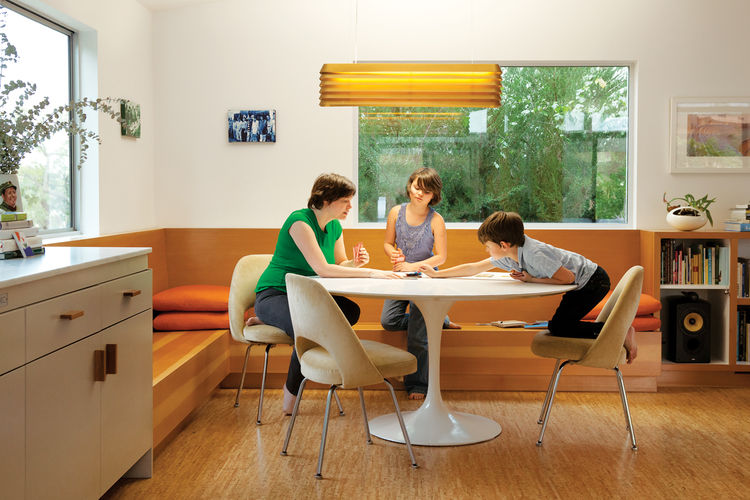 Modern dining area with curved table and Louvre Light